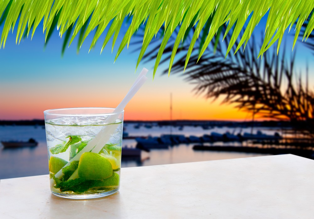 Cocktail Mojito in Balearic island sunset and palm trees